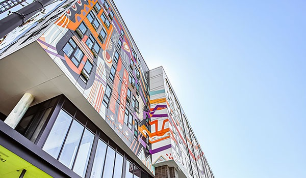 Colorful mural on Orenda building
