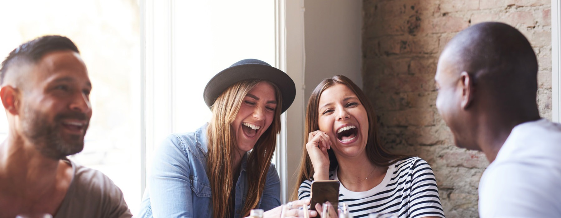friends having drinks and laughing